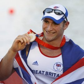 Britain's Aggar shows gold medal after winning men's single sculls at Beijing Paralympics
