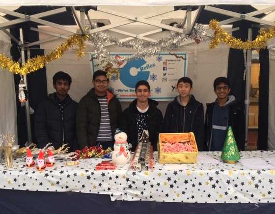 Mixing business and pleasure: Young Enterprise team's market research at the Christmas fair