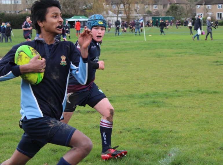 QE Rugby Sevens: home team battles in the 'group of death' as Eton notches up tournament first